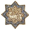 A kashan lustre pottery star tile with gazelles in foliage, persia, 14th century