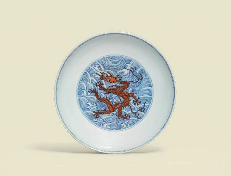 An underglaze-blue and iron-red-decorated 'Dragon' dish, Daoguang six-character seal mark in underglaze blue and of the period