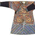 An embroidered russet silk ground dragon robe, late qing dynasty