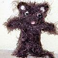 Un petit chat en laine feutrée