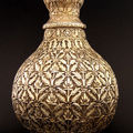 An exceptional large chased silver-gilt lidded vase, silver, india, 18th-19th c