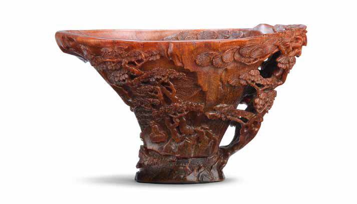 A rare rhinoceros horn 'riverscape' libation cup, 17th century