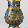 A small cloisonné enamel pear-shaped vase, hu, qianlong four-character mark cast in relief within a square and of the period