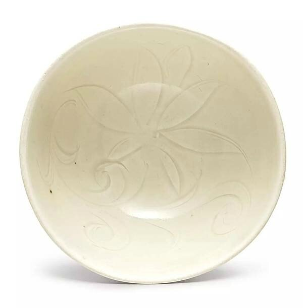 A small carved 'Ding' white-glazed 'lotus' bowl, Song dynasty