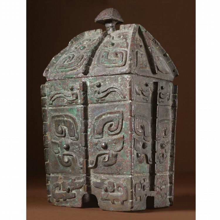 A rare archaic bronze wine vessel and cover, fangyi, Late Shang Dynasty, 13th - 11th Century BC