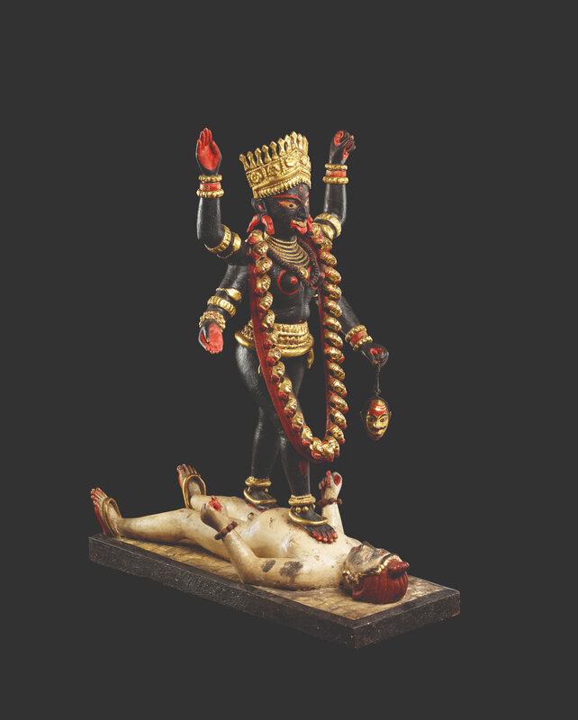 Kali striding over Shiva