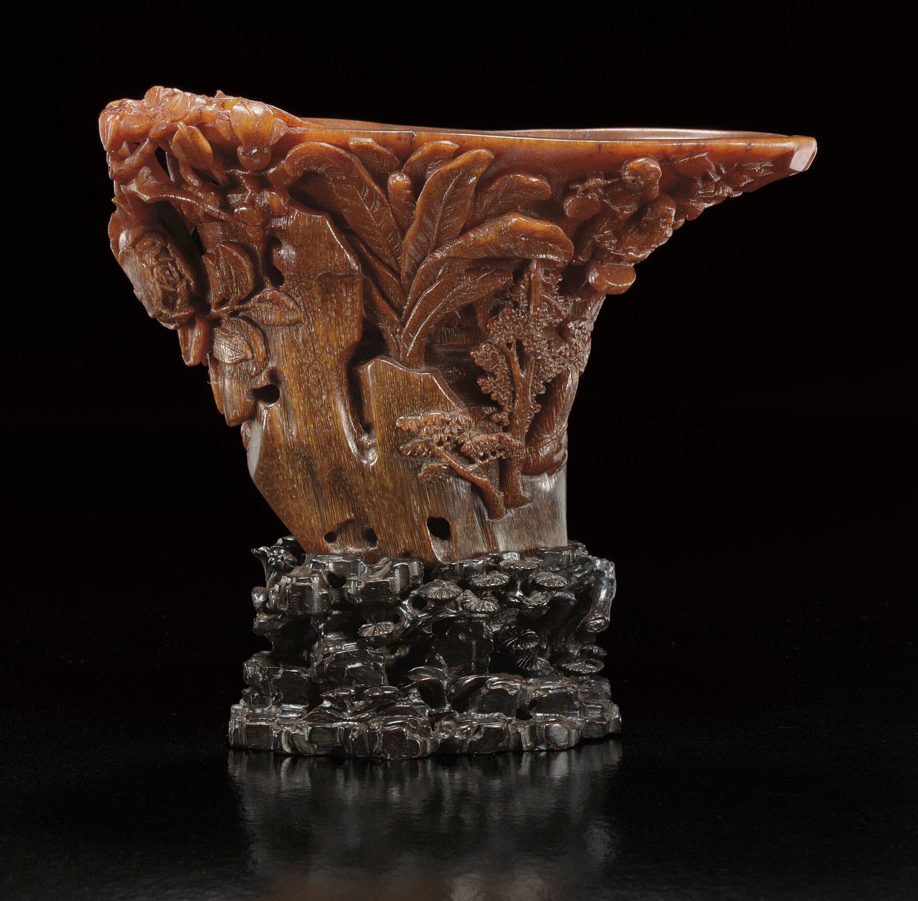 A finely carved rhinoceros horn 'Boys' libation cup, Ming dynasty, 17th century
