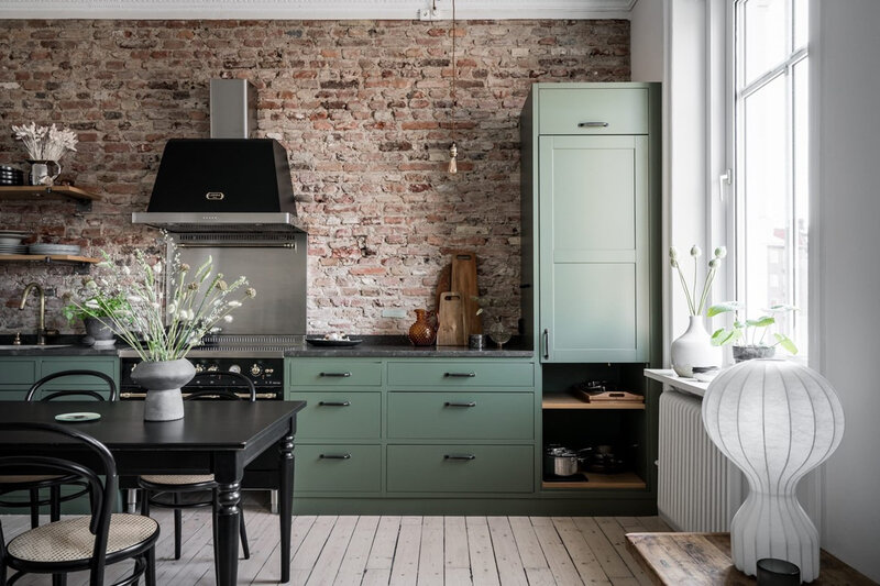 The+Nordroom+-+A+Swedish+Apartment+With+A+Green+Kitchen+and+Exposed+Brick