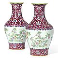 A fine pair of ruby-ground famille-rose vases, seal marks and period of Jiaqing (1796-1820)