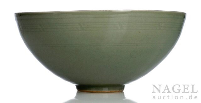 An engraved celadon glazed buddhist emblems bowl, China, Ming-early Qing dynasty