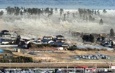 676174_a_massive_tsunami_sweeps_in_to_engulf_a_residential_area_after_a_powerful_earthquake_in_natori
