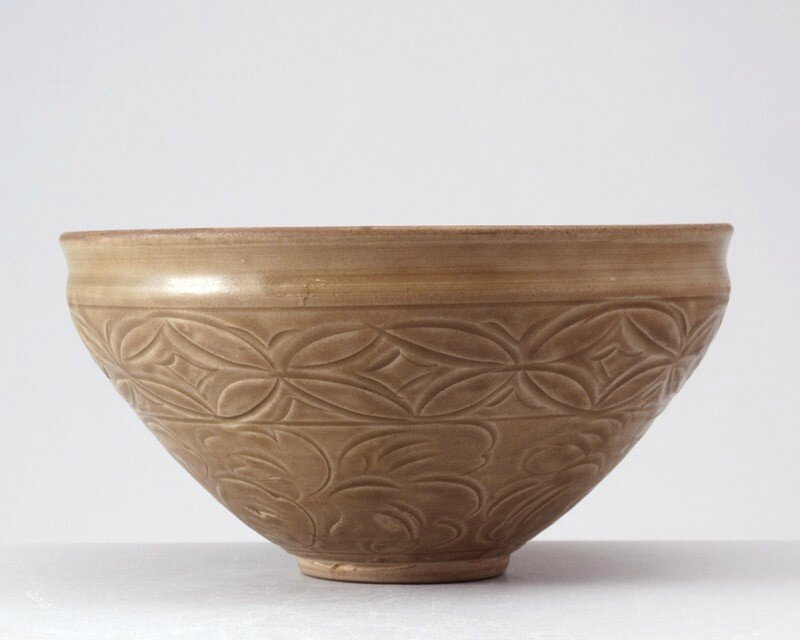 Greenware bowl with waves and floral decoration, Yaozhou kilns, 12th century, Jin Dynasty (1115 - 1234)