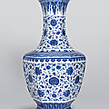A rare large blue and white 'lotus scroll' hexagonal vase, qianlong six-character seal mark and of the period (1736-1795)