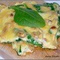 Omelette aux pousses d'épinard, comté, pignons et raisins secs