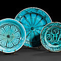 Two kubatchi fritware dishes, iran, daghestan, 17th century and a small iranian 19th century dish