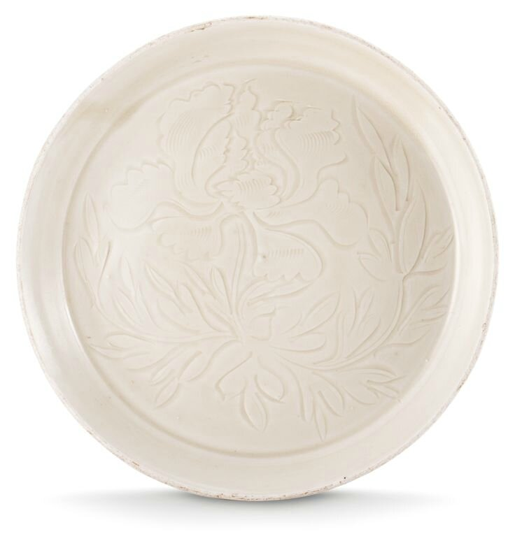 A carved 'Ding' 'Peony' saucer, Northern Song-Jin Dynasty