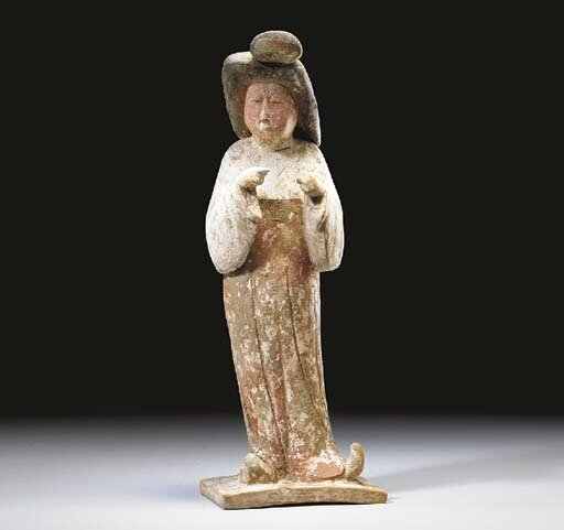 A small painted red pottery figure of a court lady, Tang dynasty (618-907)
