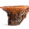 A rare and fine rhinoceros horn 'lotus and egrets' libation cup, 17th century