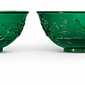 A pair of carved green glass bowls, Qing dynasty, 19th century