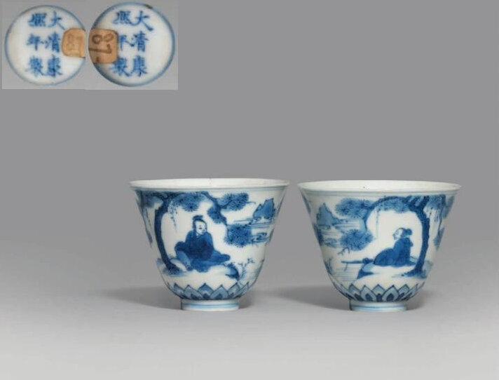 A pair of unusual blue and white 'scholar and pine' wine cups, Kangxi six-character marks in underglaze blue and of the period (1662-1722)