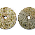 Two hardstone bi discs, northwest or southwest china, 2nd millennium bc
