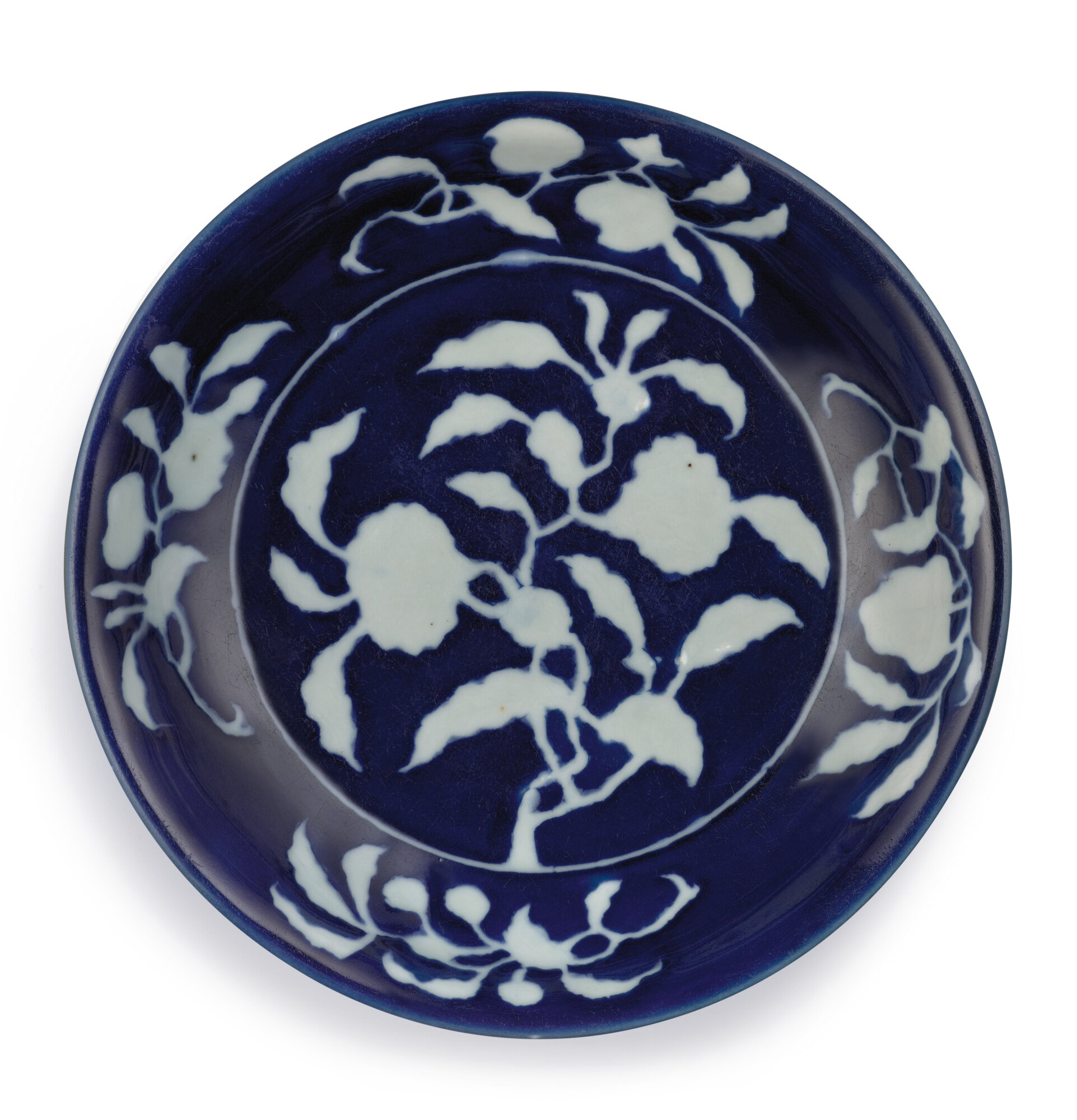 An exceptionally rare and important blue and white reverse-decorated 'pomegranate' dish, mark and period of Xuande