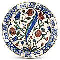 An iznik pottery dish, circa 1680, ottoman turkey & an iznik glazed fritware dish, 17th century