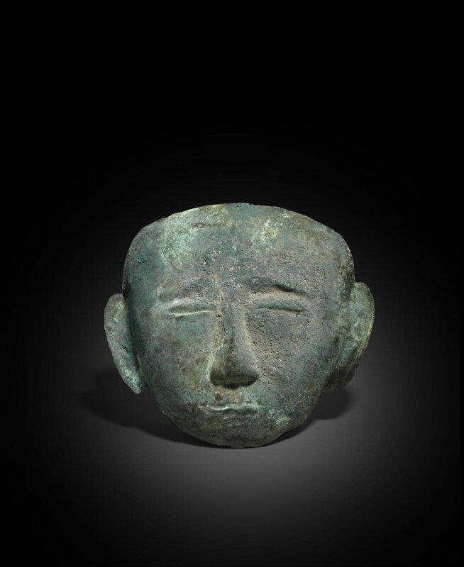 A gilt copper alloy funerary mask