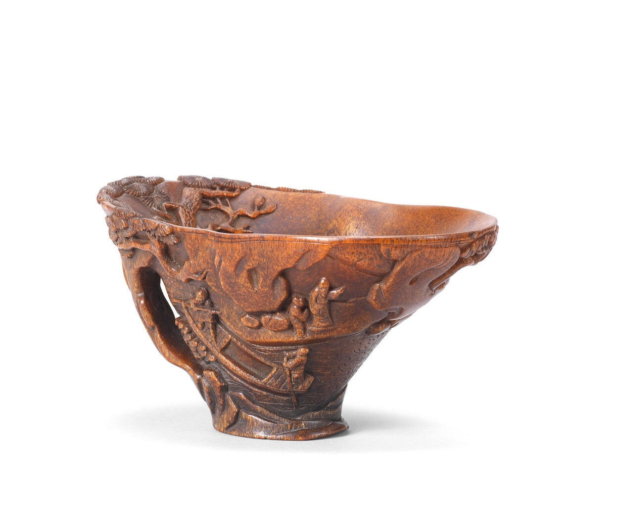 A rhinoceros horn 'scholar and pine' libation cup, 17th-18th century
