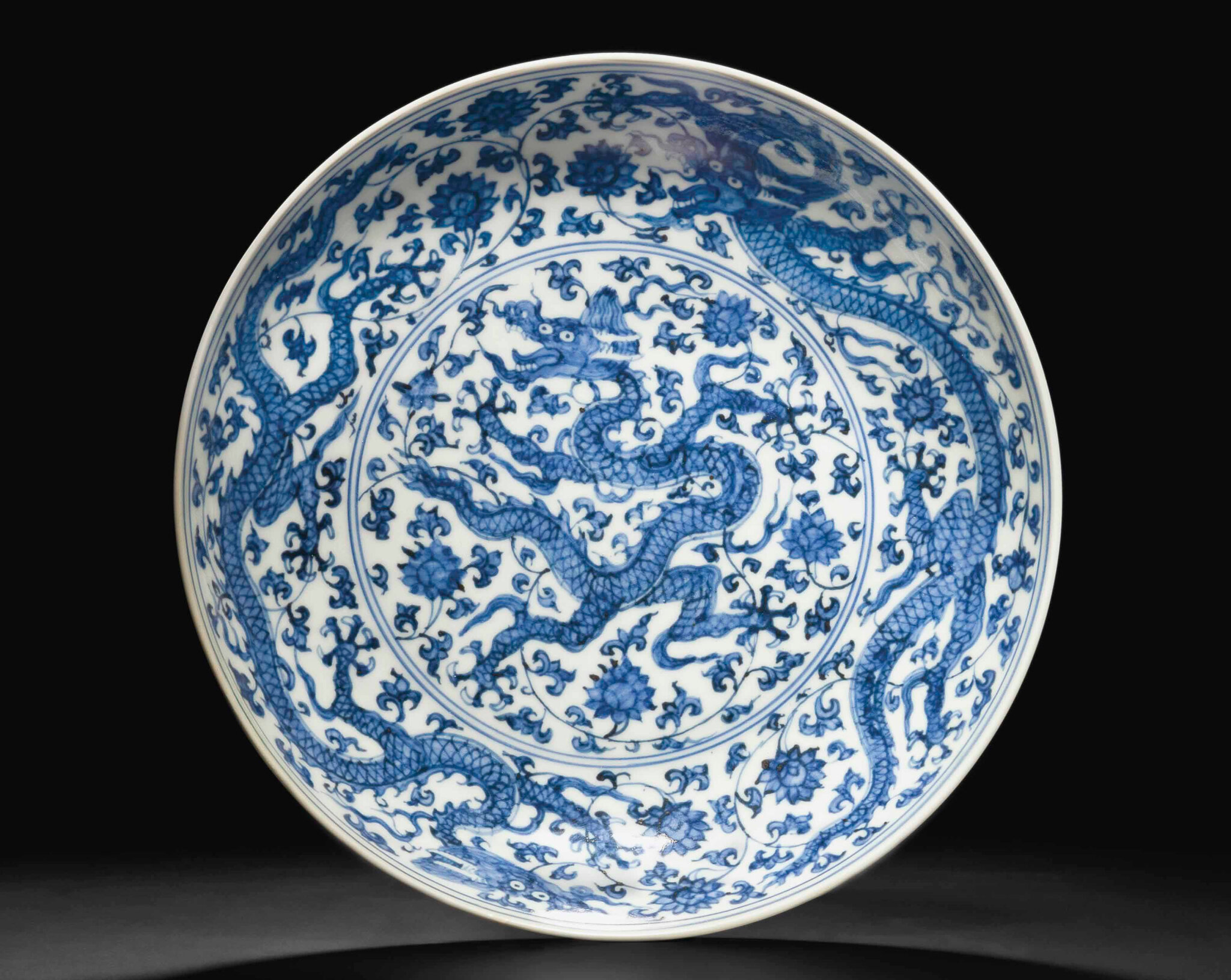 A blue and white 'dragon' dish, Zhengde four-character mark in underglaze blue within a double circle and of the period (1506-1521)