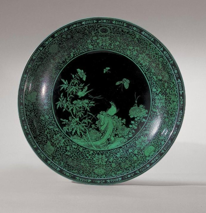 An important and rare green enamel and black-ground charger, mark and period of Qianlong (1736-1795)