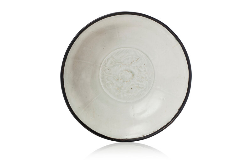 A Dingyao 'Twin fish' lobed bowl, Song dynasty