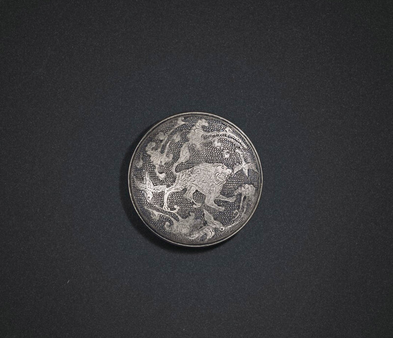 2019_NYR_18338_0565_001(a_small_parcel-gilt_silver_mythical_beast_circular_box_and_cover_tang)