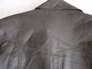 Veste simili cuir brun détails