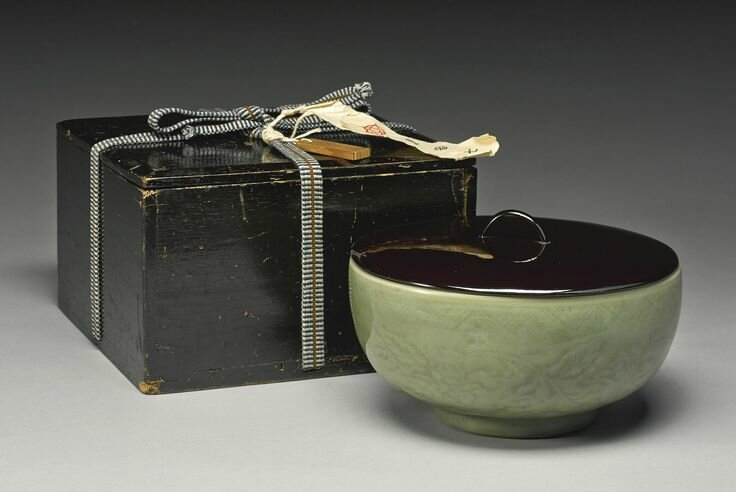 A carved 'Longquan' deep bowl, Ming Dynasty, Yongle period4