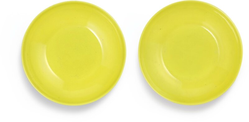 A rare pair of lemon-yellow-enamelled saucers, Marks and period of Yongzheng (1723-1735)
