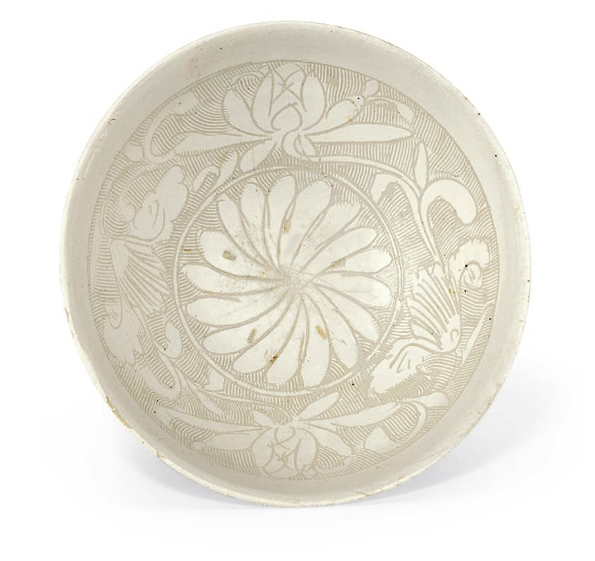 A large carved Cizhou bowl, Jin-Yuan dynasty (1115-1368)