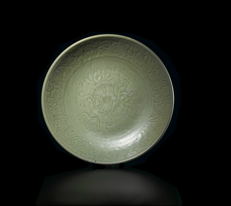 Fine and Massive Chinese Longquan Celadon Dish, Yuan-early Ming dynasty, paper label for Bluett & Sons, London. Dimensions: 46 cm (18 in.). Provenance: Collection of Andrew Williams Esq., Oxfordshire. Photo courtesy Woolley & Wallis, Salisbury, Wiltshire.