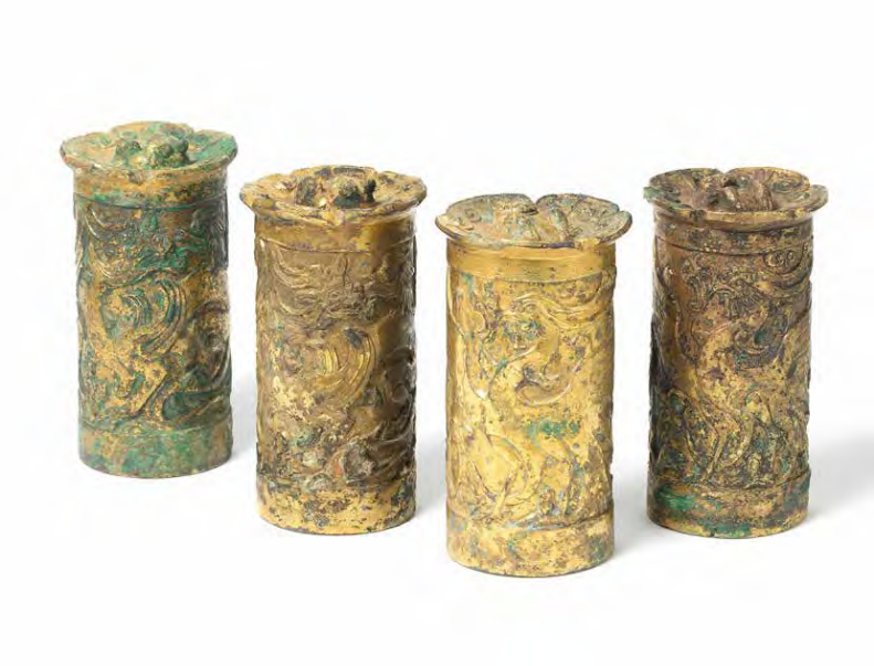 A very rare set of four archaic gilt-bronze axle caps, Han Dynasty (206 BC-AD 220)