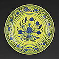 A rare underglaze-blue and yellow-enamelled 'lotus bouquet' charger, mark and period of yongzheng (1723-1735)
