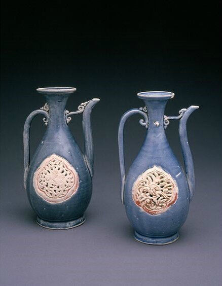 Pair of blue glazed ewers with openwork panels, Vietnam, 15th-16th century