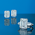 An important pair of 8.15 and 8.01 carats rectangular-cut diamond ear studs & a 11.58 carats rectangular-cut diamond ring