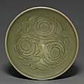 A carved Yaozhou 'Chrysanthemum' bowl, Northern Song-Jin dynasty, 12th-13th century