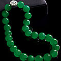 An impressive jadeite bead and diamond necklace