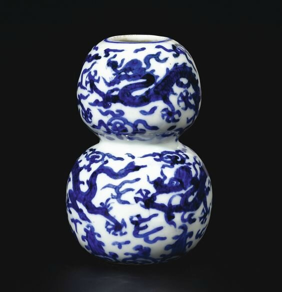 A rare small blue and white 'dragon' double-gourd vase, Mark and period of Jiajing (1522-1566)
