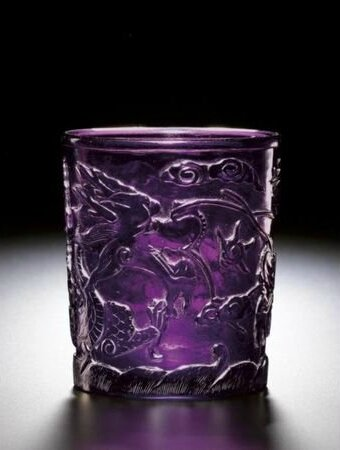 An aubergine glass 'dragon' cup. Wheel-cut mark and period of Qianlong. photo courtesy Sotheby's