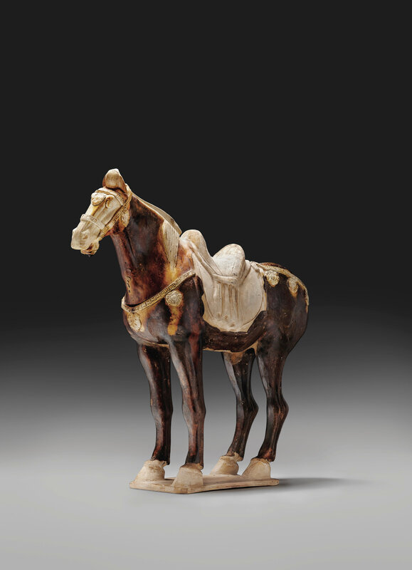 A large chestnut-glazed pottery figure of a horse, Tang dynasty (618-907)