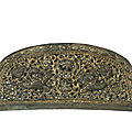 A rare parcel-gilt bronze reticulated 'flying geese' comb top, tang dynasty (618-907)