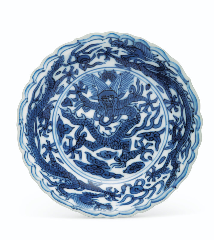 A blue and white 'dragon' dish, Wanli six-character mark in underglaze blue within a double circle and of the period (1573-1619)