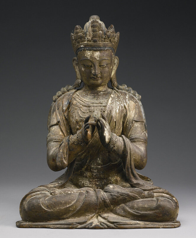 A rare carved wood figure of Vairocana, Early Ming dynasty